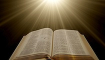 bible surrounded by rays of light