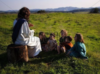 Jesus talking to a group of children